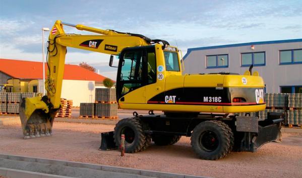 Экскаватор колёсный CATERPILLAR CATM318C